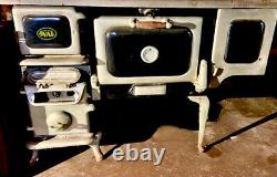 Antique Elmira /OVAL wood burning cook stove, Black And Silver, Made In Canada